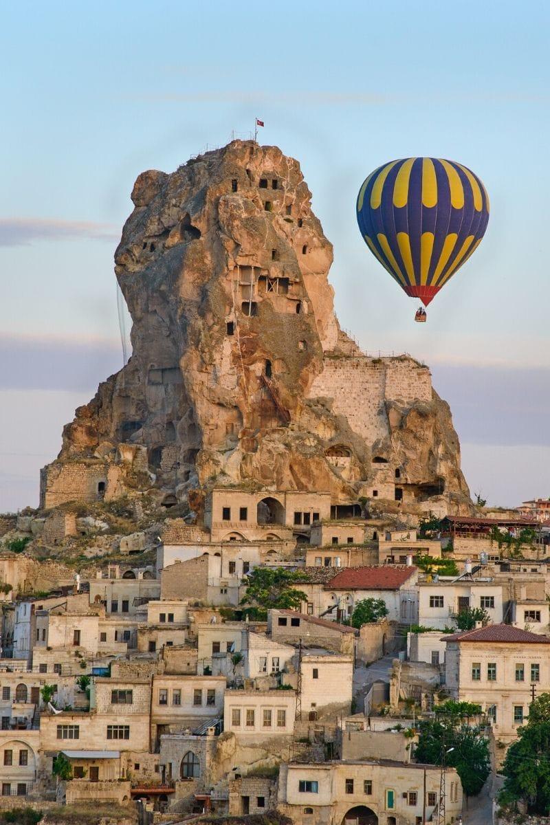 Hot air balloons in front of Uchisar Castle, Cappadocia
