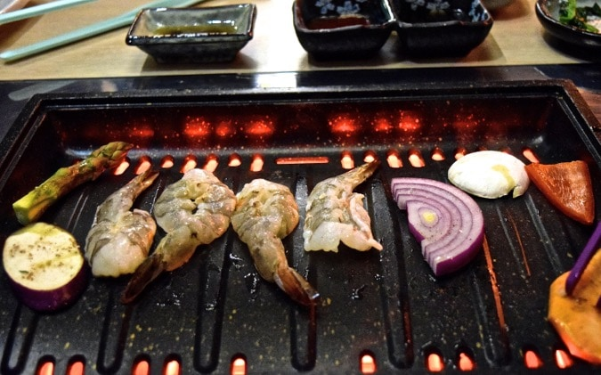 BBQing our food at SuperStar BBQ - Korean restaurant in London