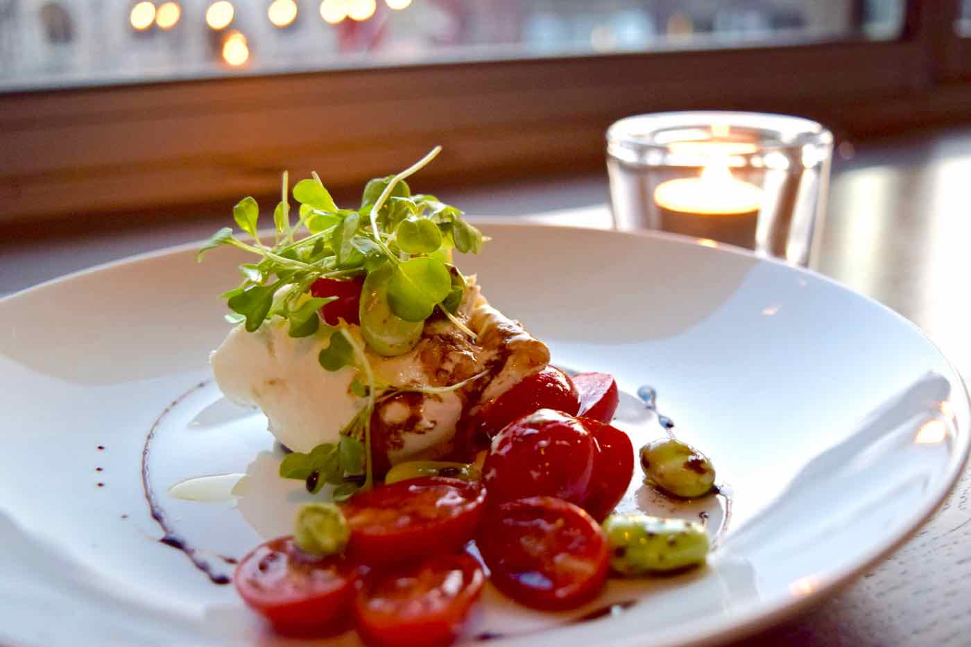 Burrata, dattarini tomatoes and broad beans at Osteria London