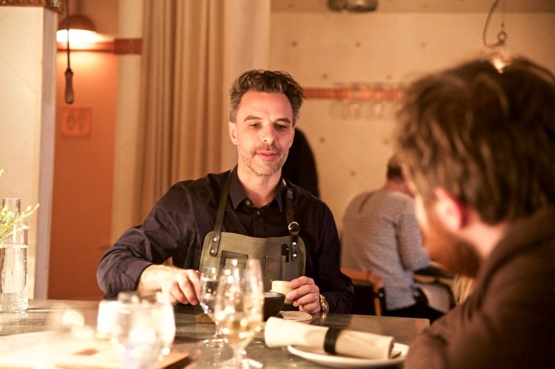 Sommelier Max with customers at Restaurang Ekstedt, Stockholm
