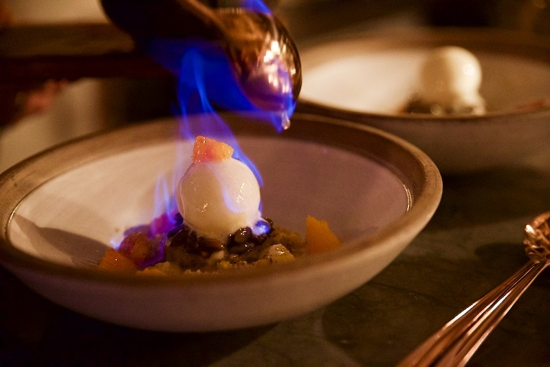 Flambe pumpkin cake dessert at Ekstedt Restaurant, Stockholm