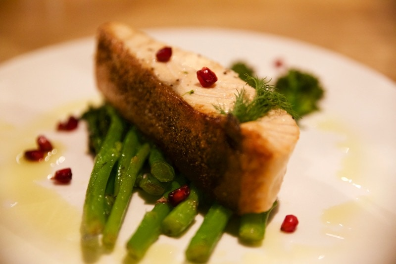 Salmon with broccoli and pomegranate at Obicà Restaurant, St Paul's, London