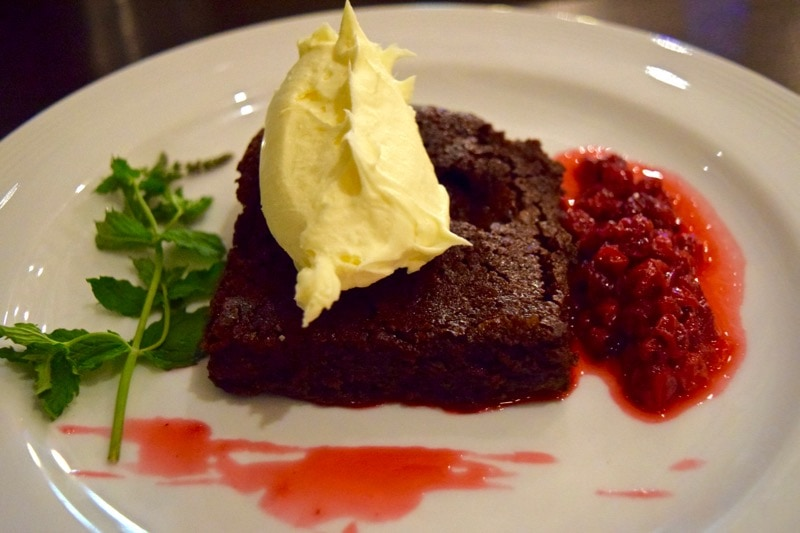 Chocolate brownie with redcurrant sauce at Villa Mansa Hotel
