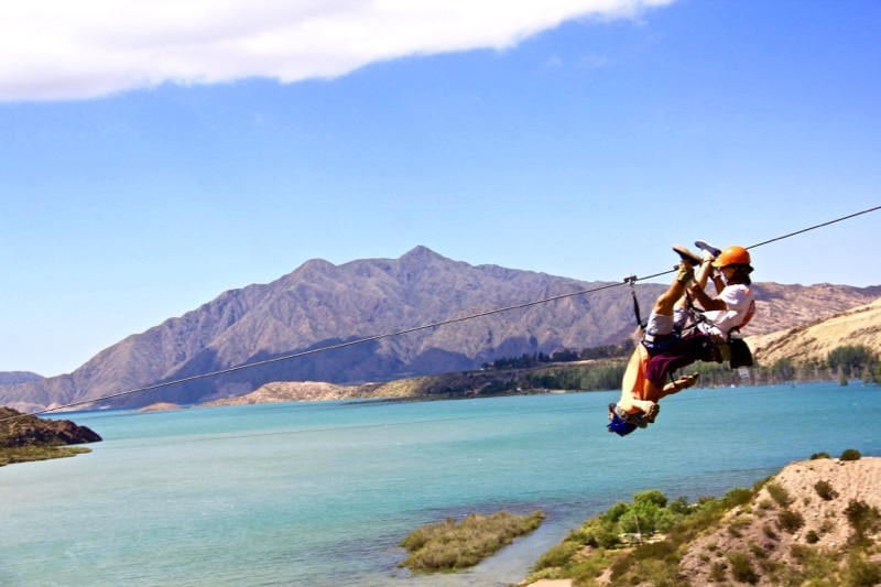 @BackpackerMacca ziplining upside-down over Lake Potrerillos in Argentina