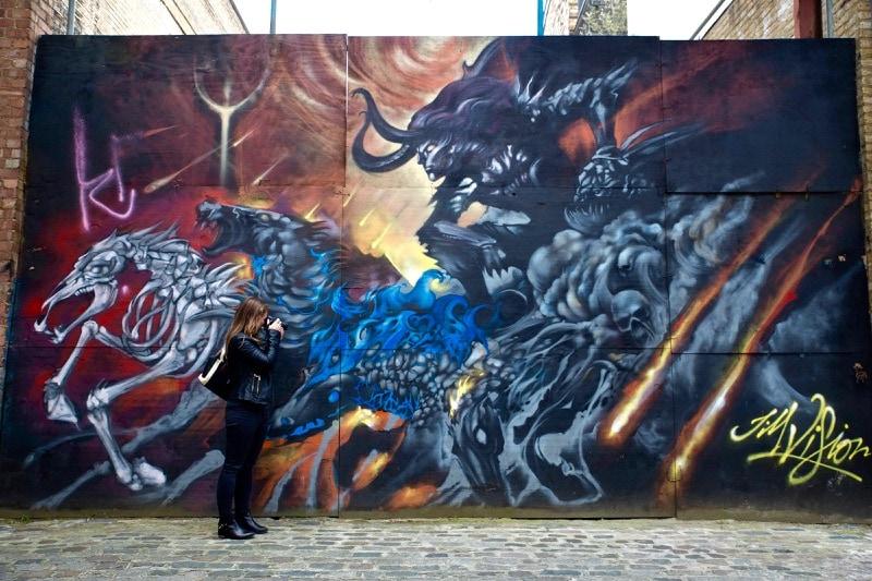 Taking photos on the Sidestory Street Art Tour, London
