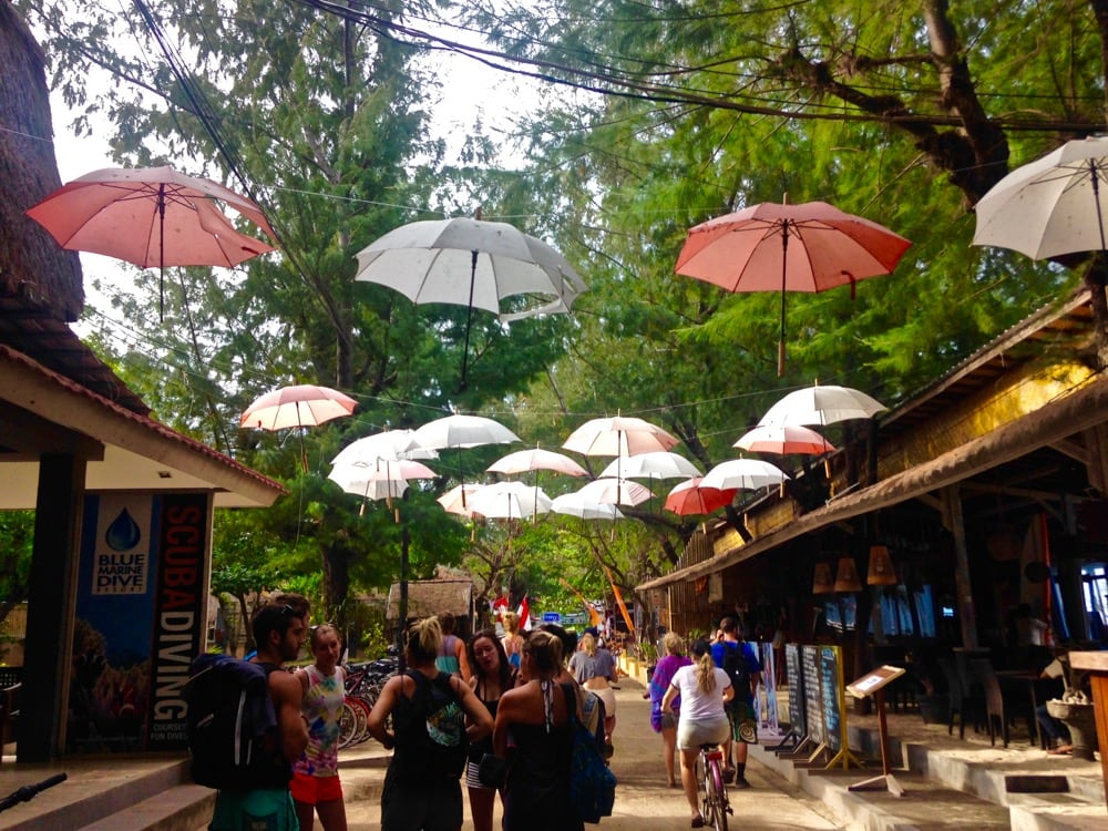 Umbrellas over Main Street in Gili T