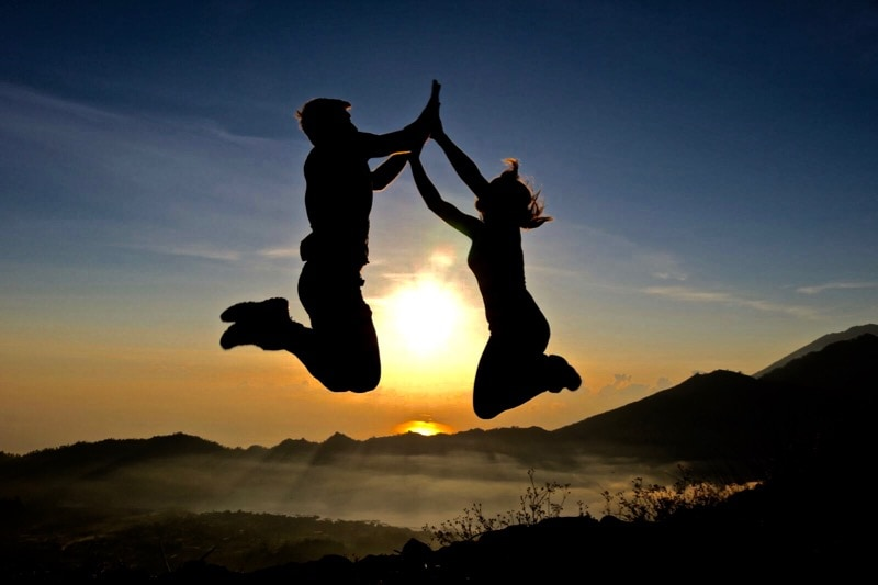 We did it! Jumping over the sun at the top of Mount Batur, Bali