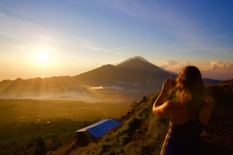 Photographing the incredible view of sunrise from Mount Batur, Bali