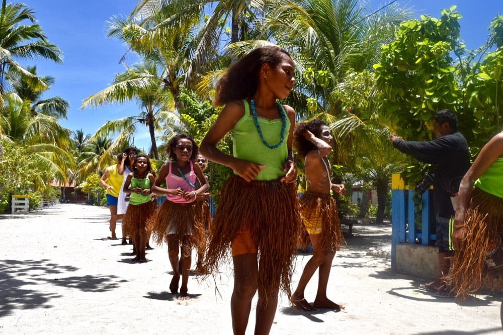 Kids dancing in Arborek Village, Raja Ampat