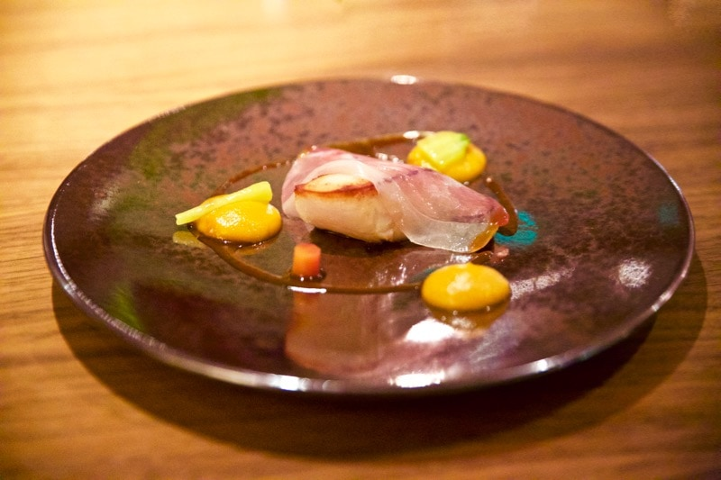Roasted Isle of Skye scallop with wee three pigs air dried ham, heritage carrots and a pork and shellfish tarragon dressing at The Artichoke, Amersham