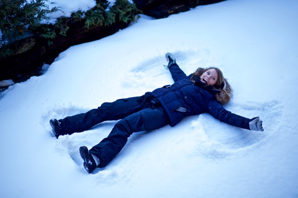 Making snow angels in Zermatt, Switzerland