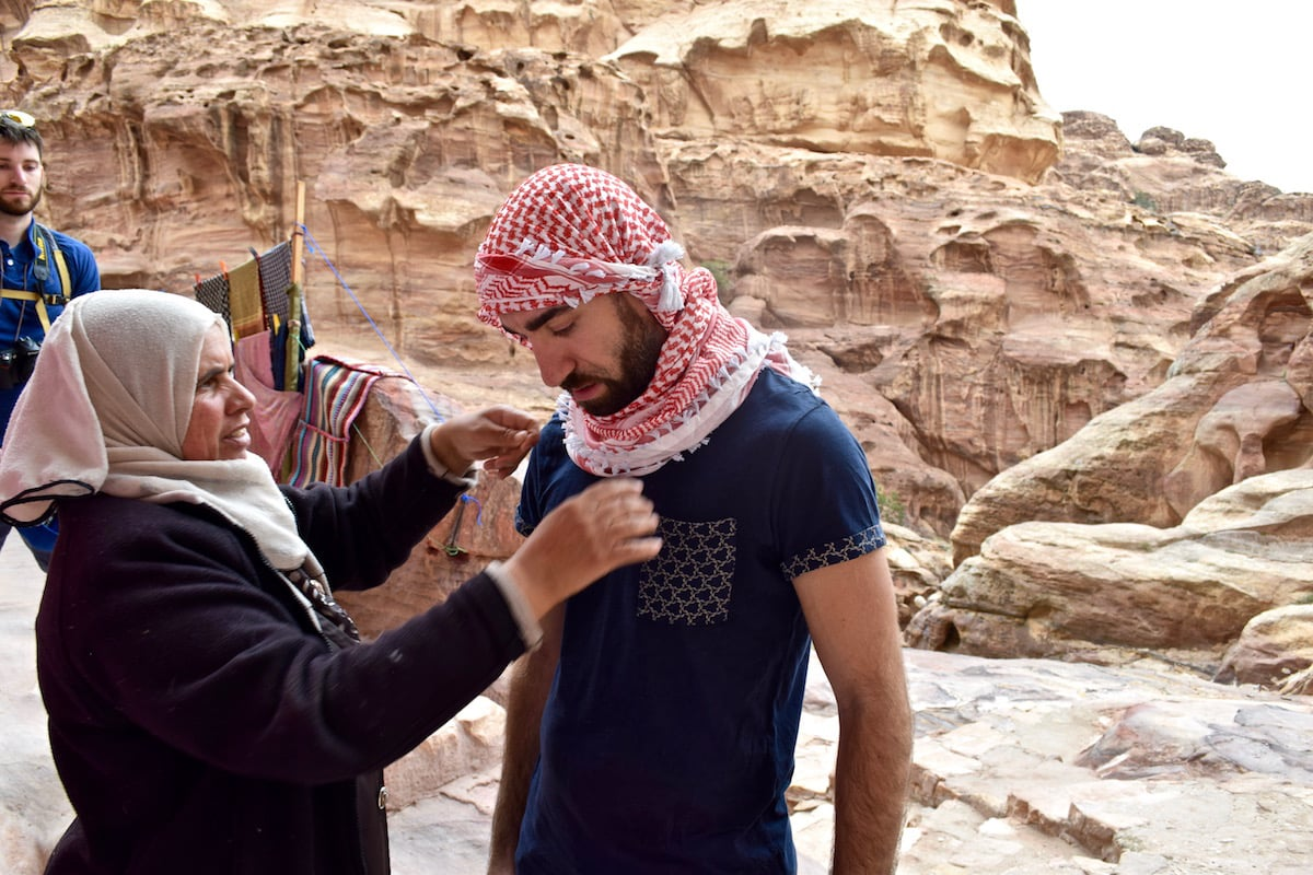 hot sale online 7c7d3 265ac Traditional scarf being put on in Petra, Jordan