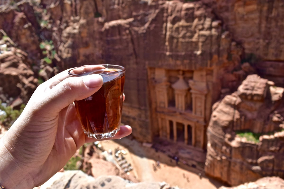 Tea time above The Treasury in Petra, Jordan