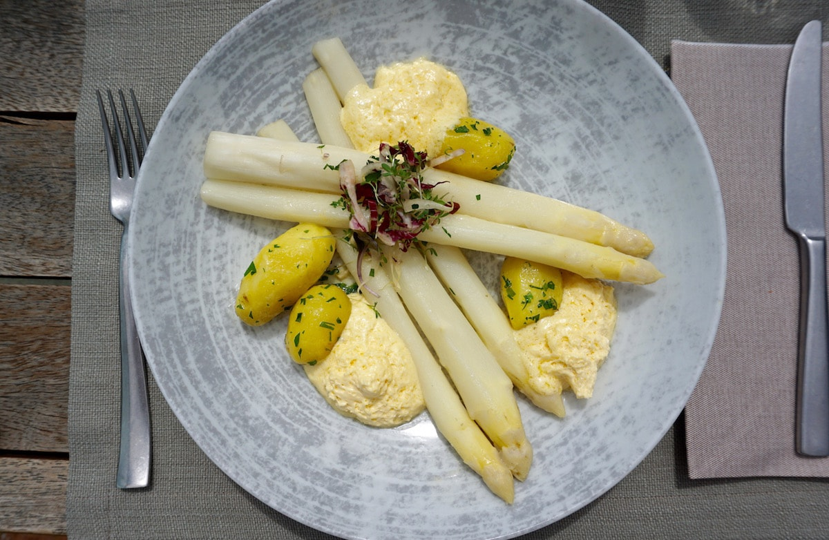 Seasonal white asparagus with bernaise at Aiola Upstairs in Graz, Austria