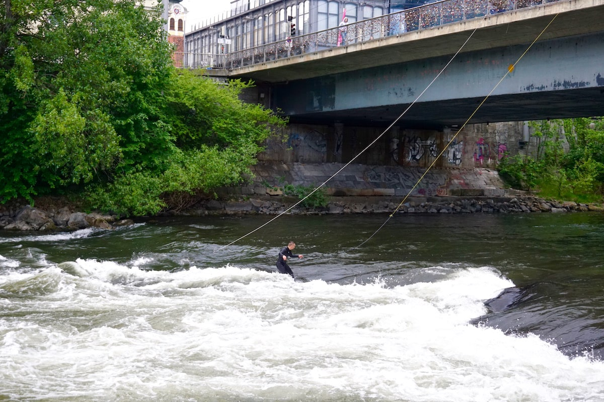 Surfing on the River Mur in Graz, Austria