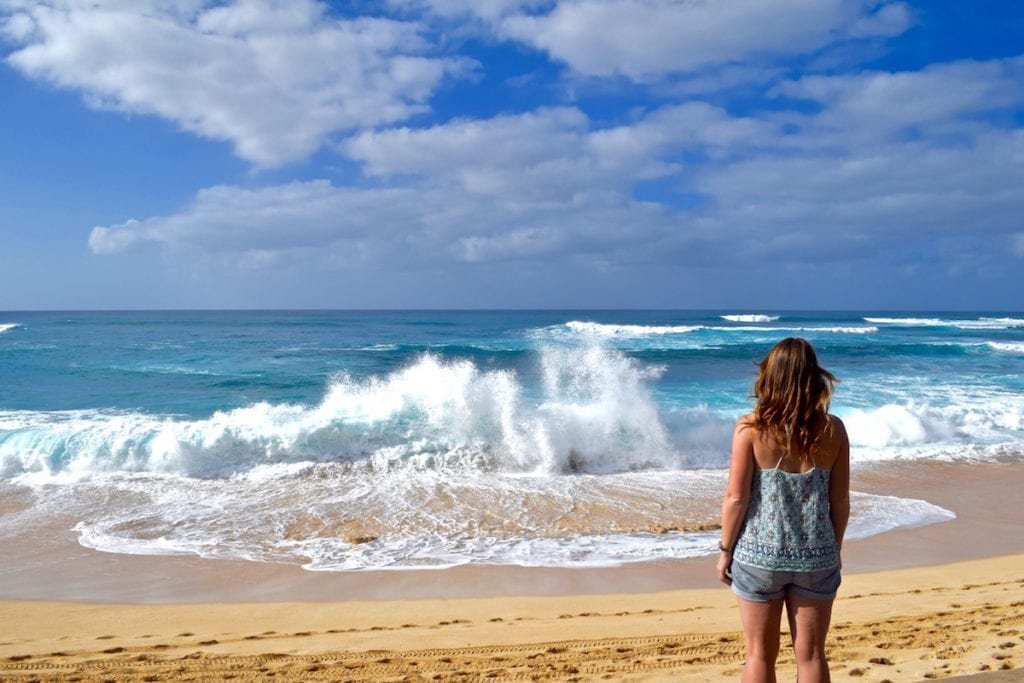 Watching surfers on the North Shore, Hawaii