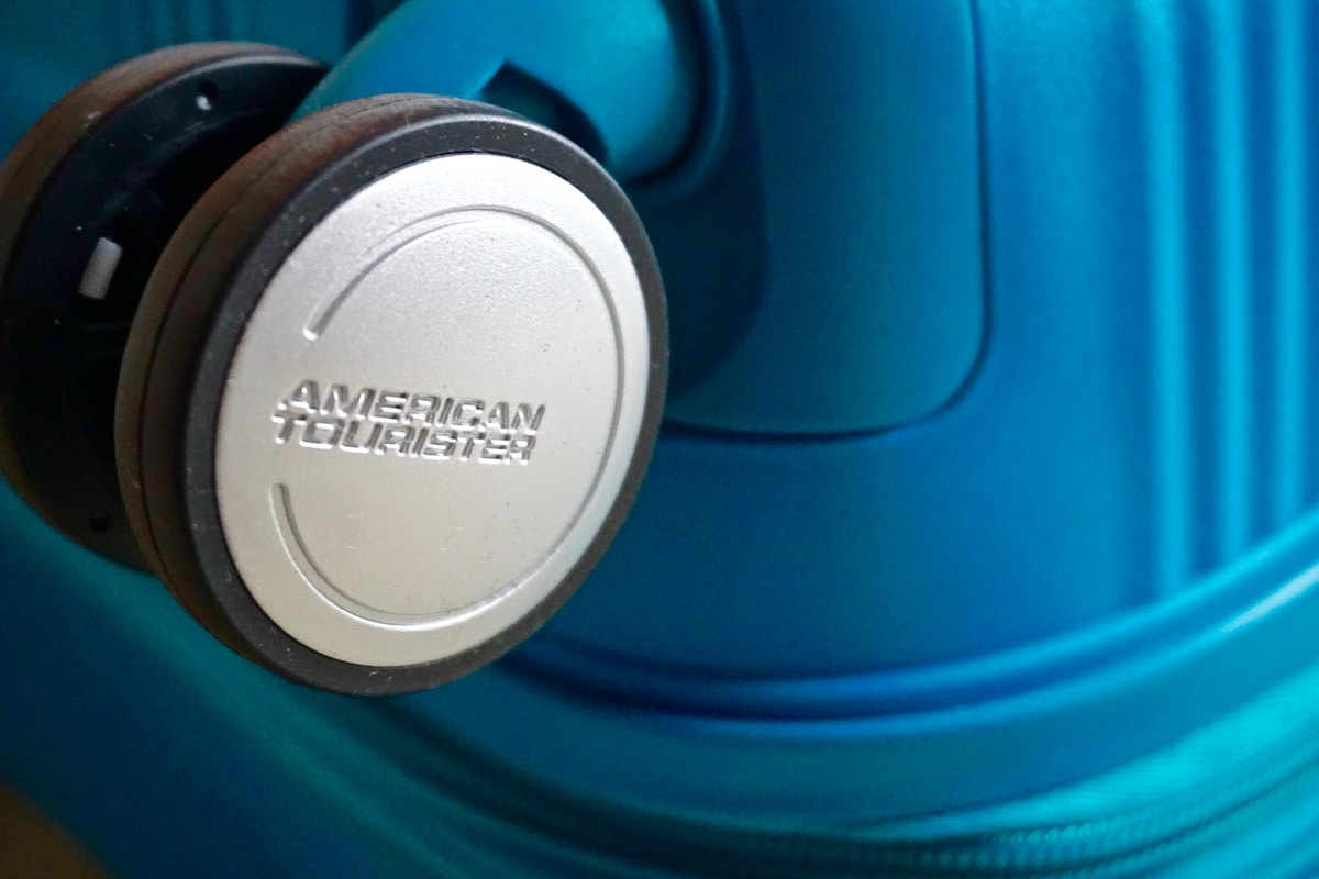Branded spinner wheels on the American Tourister Soundbox Suitcase