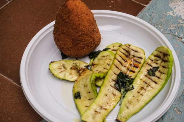 Tasty arancini and courgette salad in Salina, Sicily