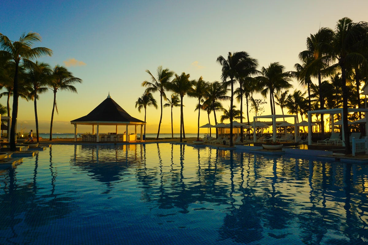 Sunset pool views at Heritage Le Telfair Mauritius