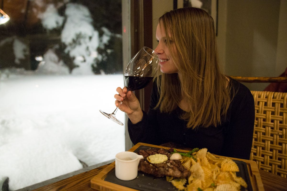 Enjoying dinner overlooking the snow at Deer Lodge, Lake Louise