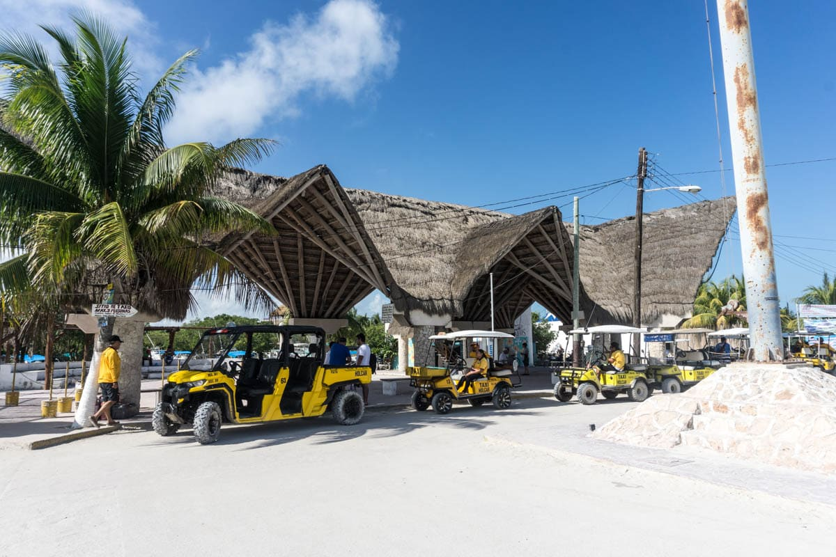 Golf buggies waiting at Holbox Ferry Port