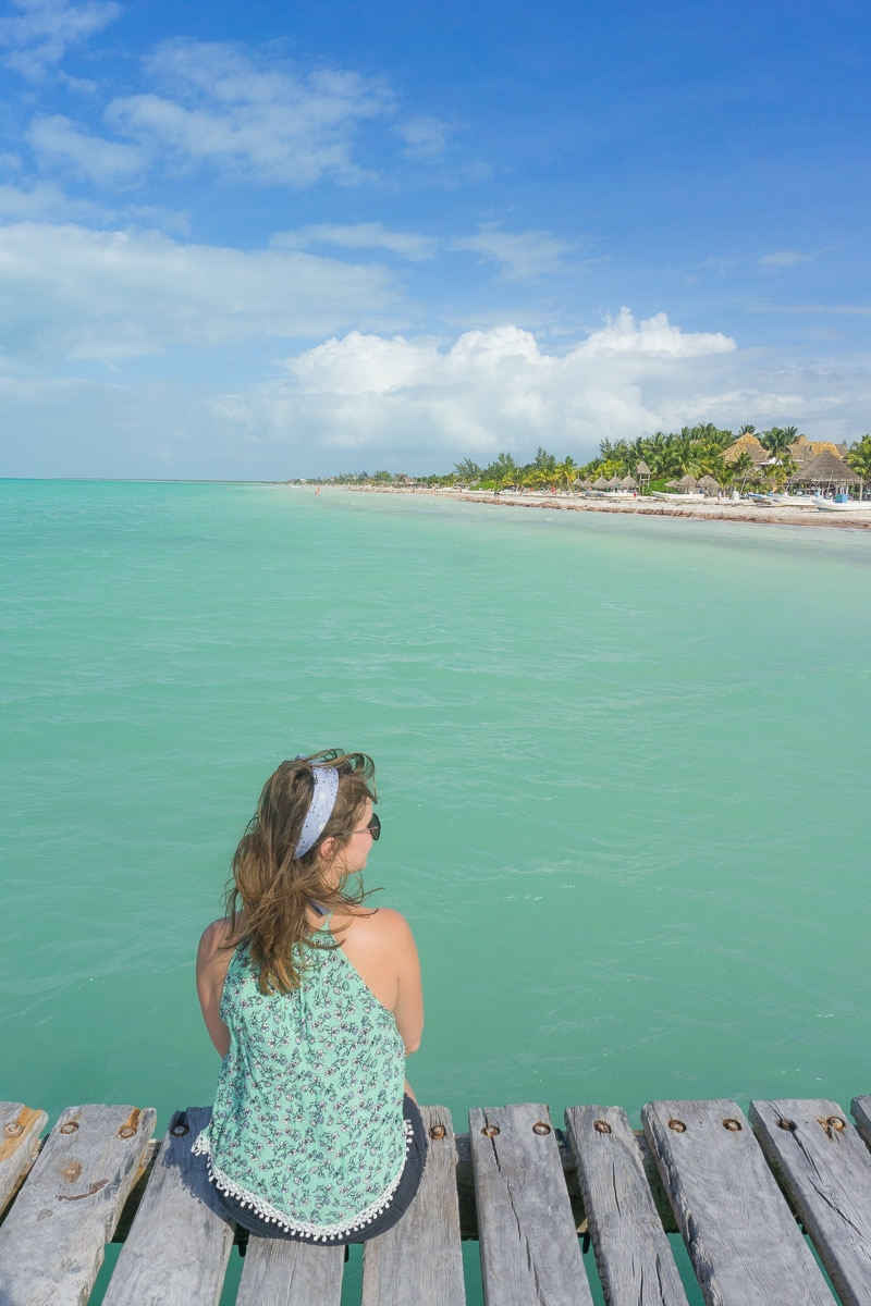 Sitting on the pier on Isla Holbox, Mexico