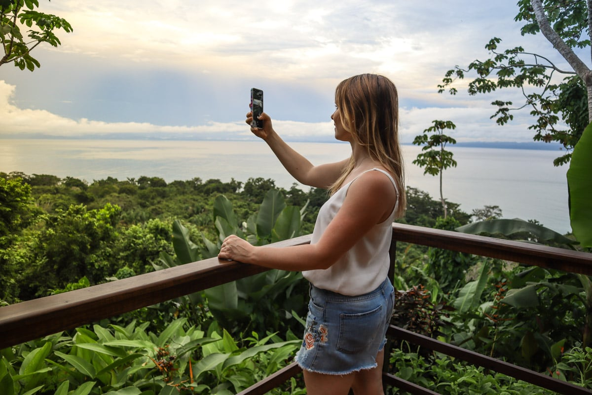 Taking photos of the views from my terrace at Lapa Rios, Costa Rica