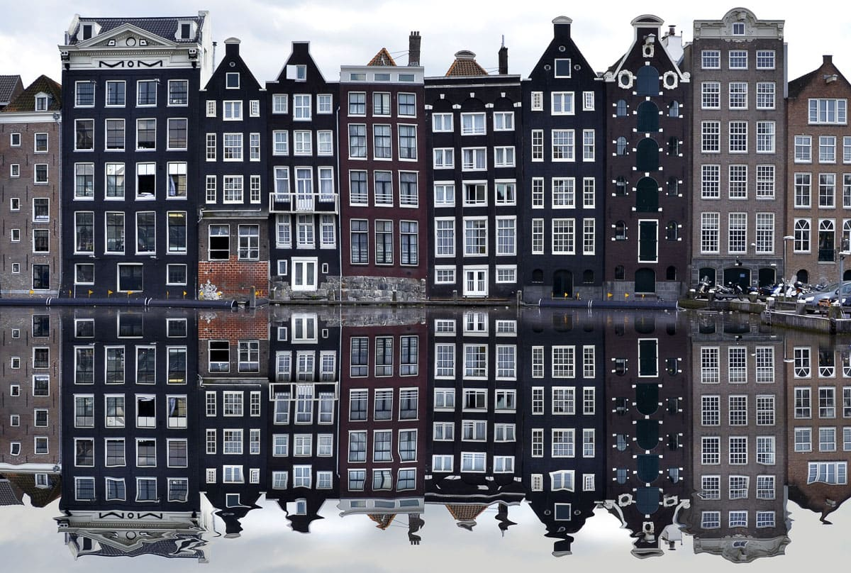 Beautiful mirror reflections of the Dutch houses in Amsterdam