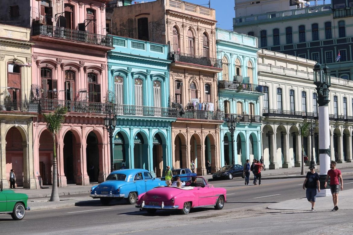 Vintage cars and colourful buildings on the Malecon, Havana