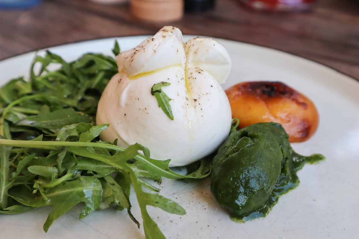 Burrata with rocket, basil sorbet and nectarine at Salonplafond, Vienna