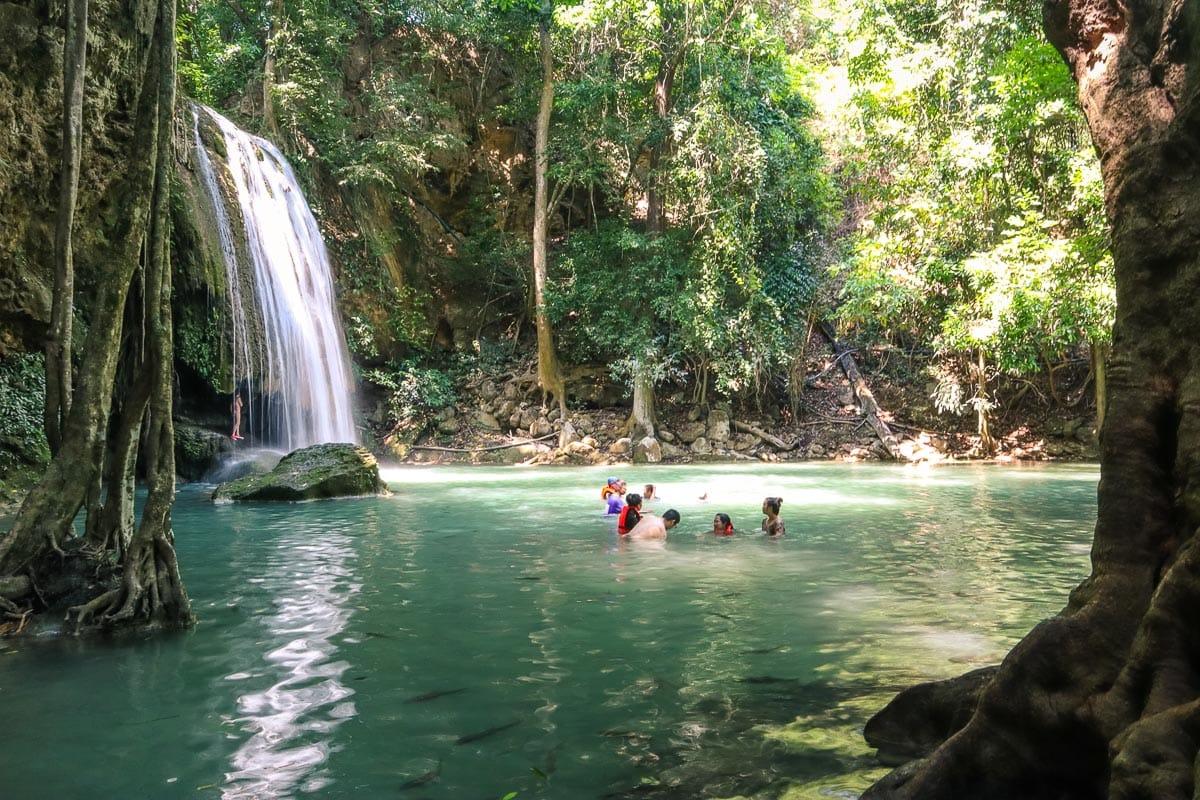 Swimming at Erawan Waterfalls, Thailand