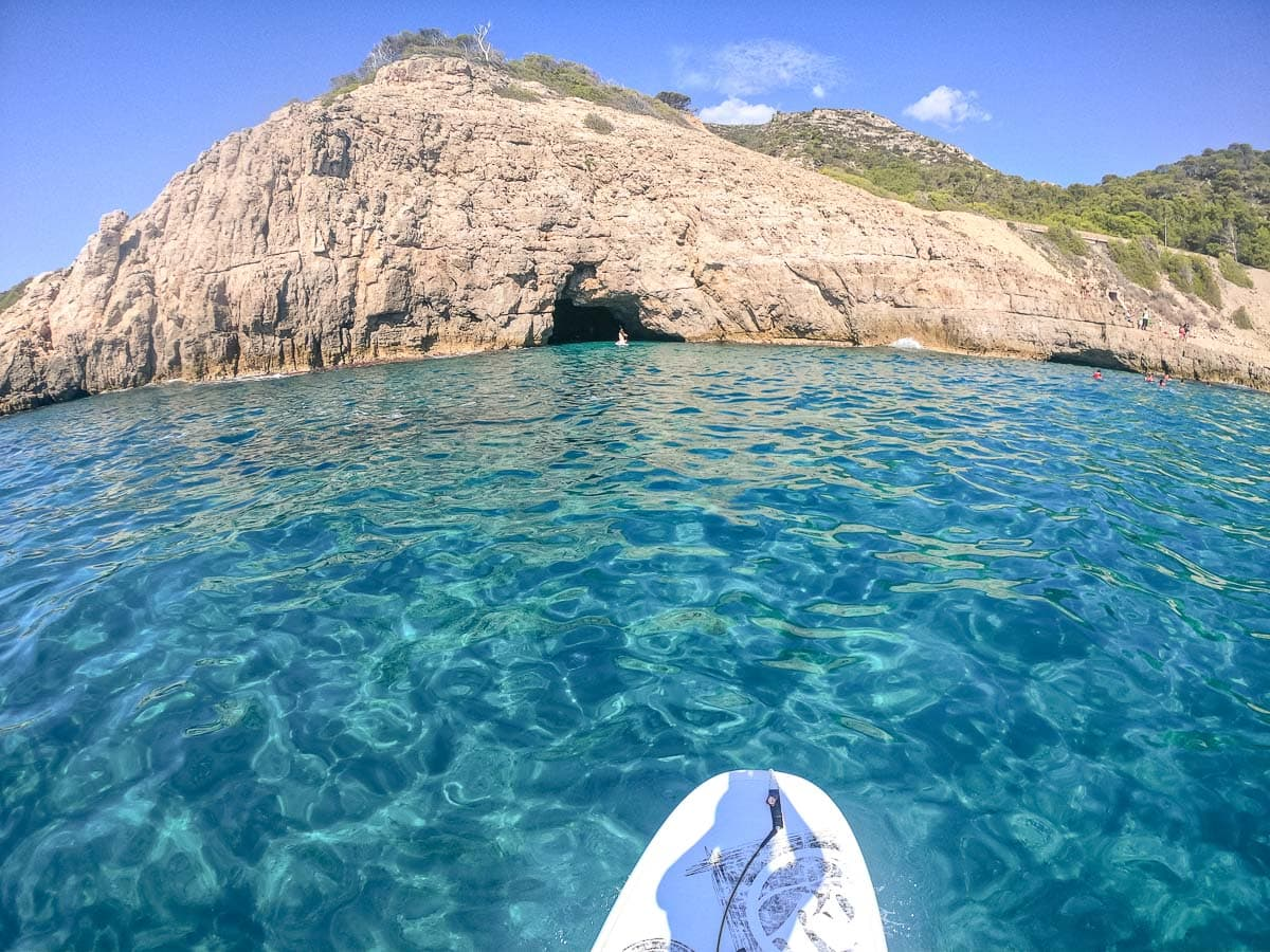 Paddle boarding to Cova del Llop, Catalonia