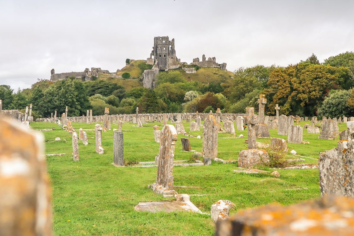 Graveyard in Corfe Castle with ruins in the background