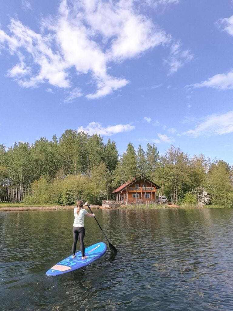 Paddle boarding at Log House Holidays in the Cotswolds