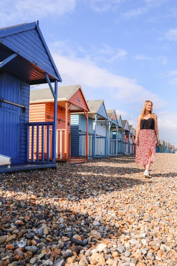 Walking past the beach huts in Herne Bay